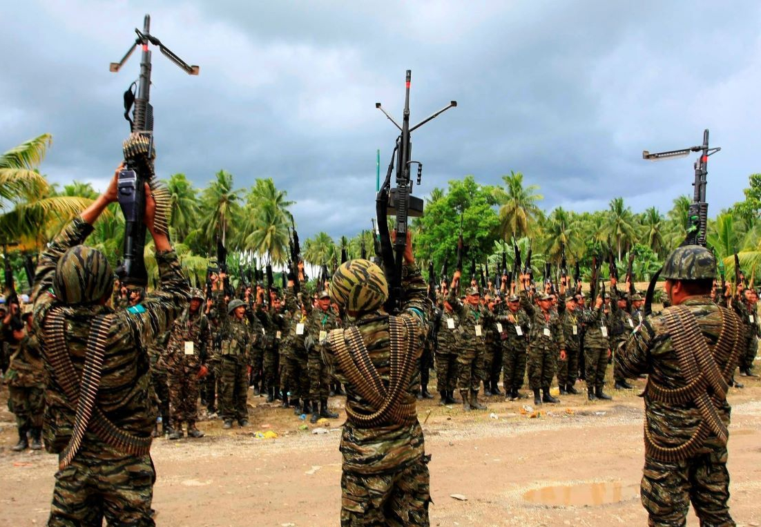 Gov't Panel Pays Historic Visit to Ex-Enemy MILF's Camp Rajamuda